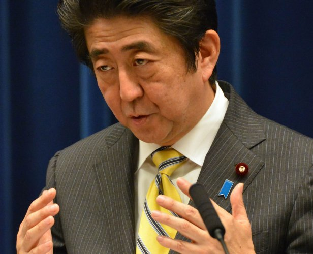 Japan pushing military reform despite fiery suicide bid