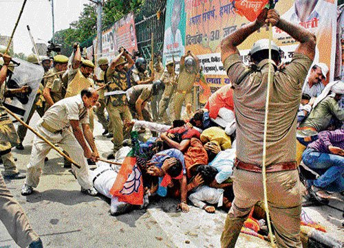 BJP workers clash with cops, over 50 injured