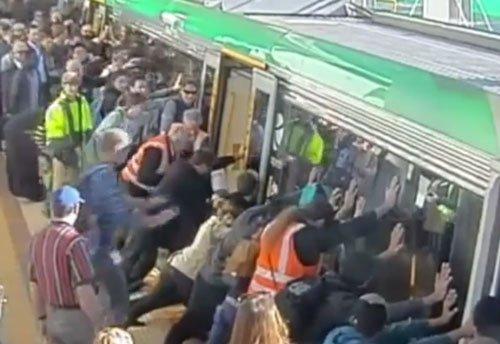 Trapped commuter freed after Australians tilt train