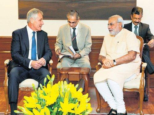 Hagel briefs Modi on Iraq hours before air strike