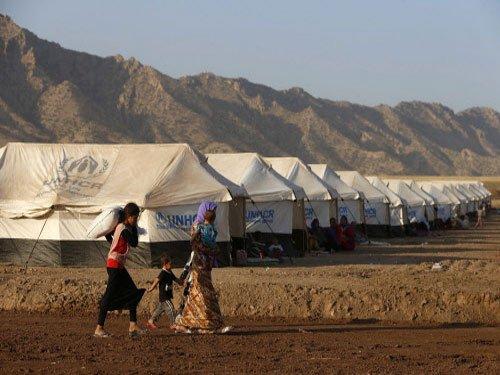 Jihadists 'massacre' Iraq villagers as world ups response