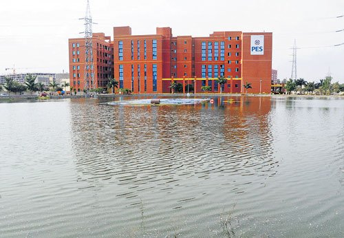 Students evacuated in boats after Friday rain floods PES