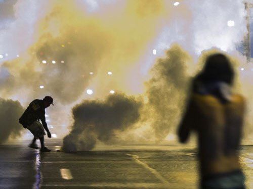 Protesters defy curfew in riot-shaken US town