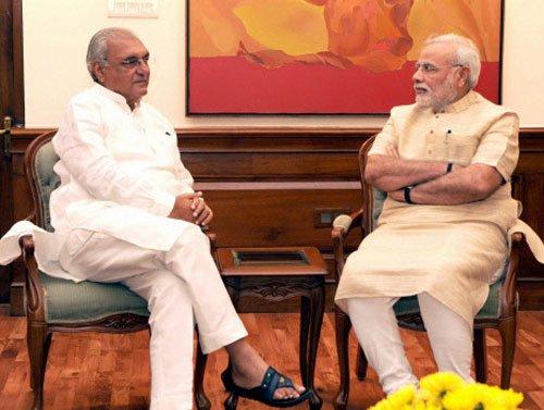 Hooda buries 'jeering' incident, meets Modi