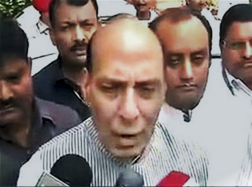 Oppn targets govt over reports about Rajnath's son