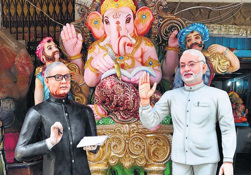 Now, Ganesha idol with Modi in tow