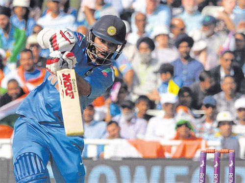 Dhawan rises from depths