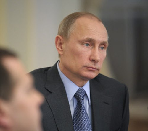 Putin says Russia committed to Ukraine peace process