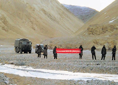 Chinese troops begin withdrawing from Indian territory