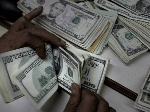 FII inflows in debt market cross Rs 1 lakh cr mark in 2014