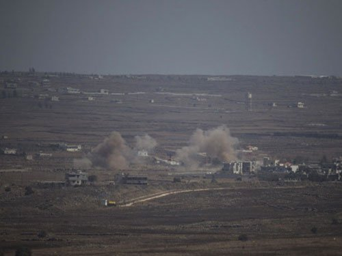US-led airstrikes target 10 IS positions in Syria