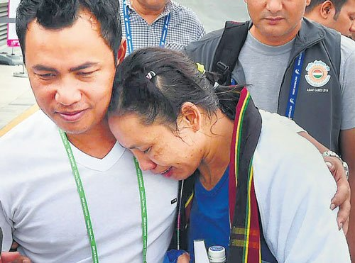 Row hits Asiad as boxer knocked out by judges