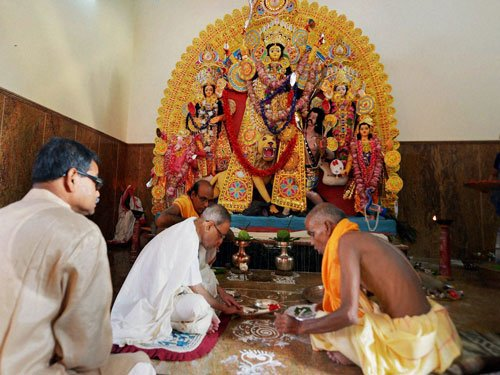 President offers puja at ancestral home, takes part in rituals