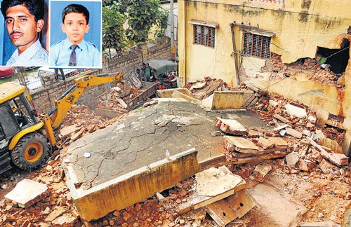 Man, 10-yr-old son buried alive as building collapses on them