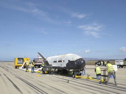 US plane on secret mission returns to Earth