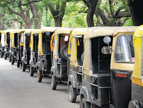 Woman spits at auto driver