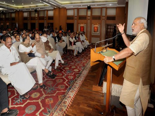 Think above politics: Modi to MPs over tea