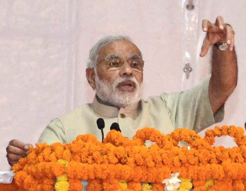 Modi wields spade, launches cleanliness drive in Varanasi