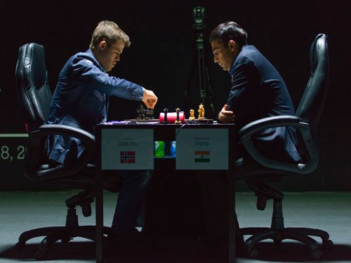 Carlsen draws first blood, takes early lead