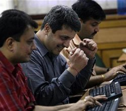 Sensex off record highs; shares of oil firms plunge