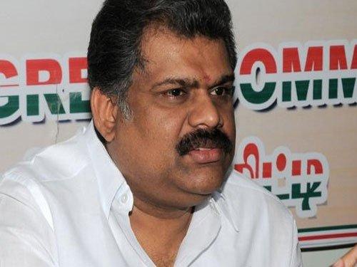 Expelled senior Congress leader G K Vasan unveils party's flag