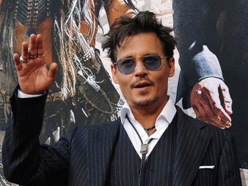 I'm living like a fugitive: Johnny Depp