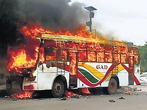 Private bus rams road median, catches fire in KR Puram
