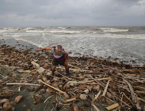 Rains lash disaster-weary Philippines as typhoon nears