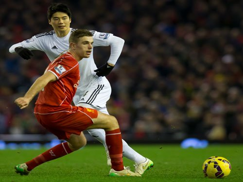 Liverpool beat Swansea in Premier League