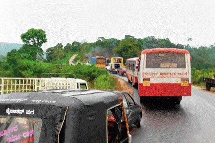Vehicular traffic continues to crawl on Charmadi Ghat road