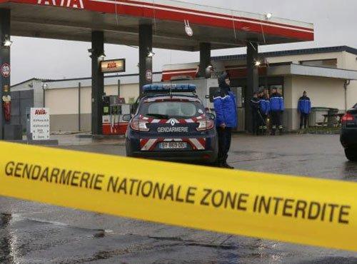 Car chase, hostage drama as Paris massacre suspects cornered