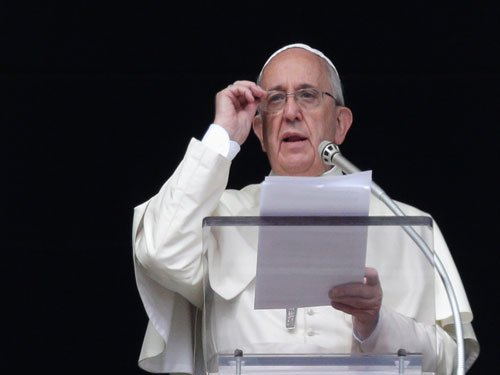 Pope flees Philippine storm, cuts short typhoon mercy trip