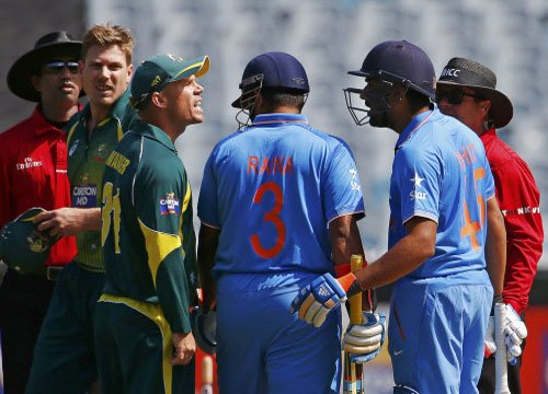 Warner fined for spat with Rohit but defends choice of words
