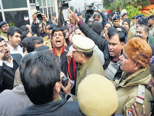 Delhi BJP chief's supporters protest, seek ticket for him