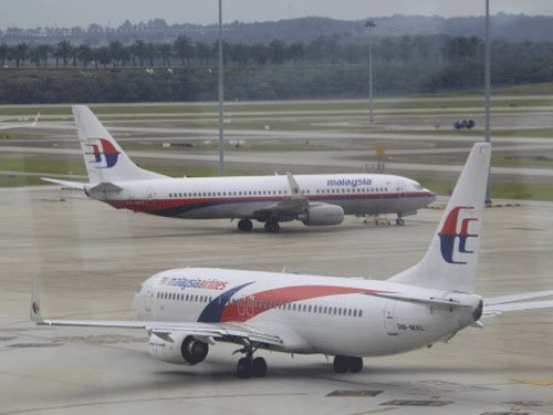 Hackers target Malaysia Airlines, threaten data dump