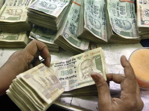 Rupee trades 61.42 vs USD in late morning deals