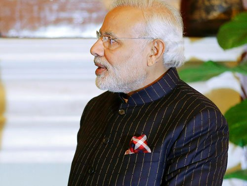 PM's suit striped with his name reflects megalomania: Ramesh