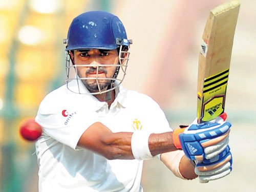 Rahul's century put champs in command