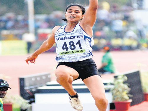 Gritty Dutee races to gold