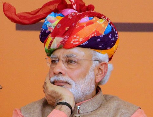 Modi seeks humble, tolerant new image after poll rout