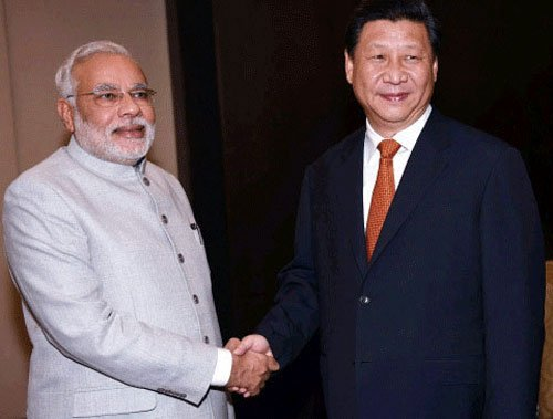 Xi, Modi hold summit-level talks in Xi'an