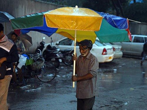 Heavy rain lashes Bengaluru, cripples normal life