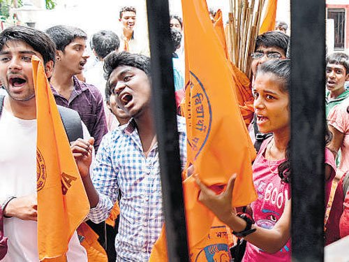 BJP youth wing protests in front of PU Board