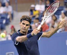 Federer has it easy, Halep upset