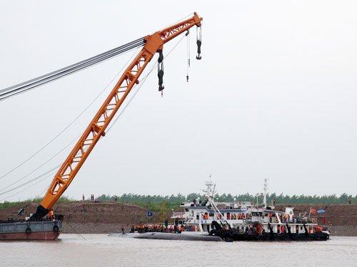 China ship capsize: rescuers race to find survivors, 26 dead