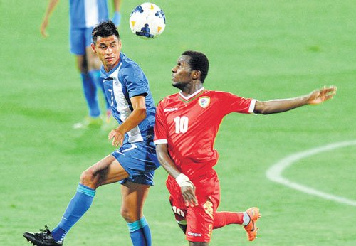 Oman fight past gritty India