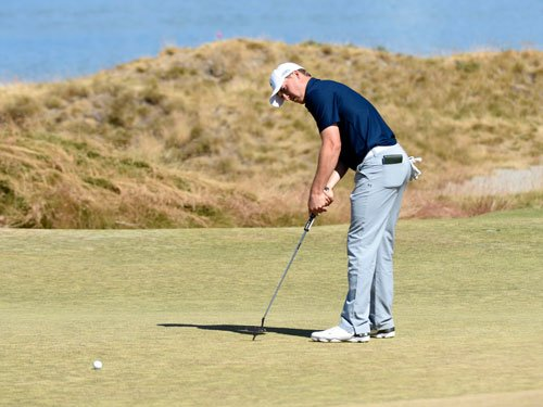 Spieth on course for rare double
