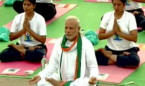 PM Modi greets people on the first International Yoga Day