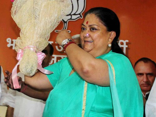 BJP fights back growing chorus for Raje's resignation