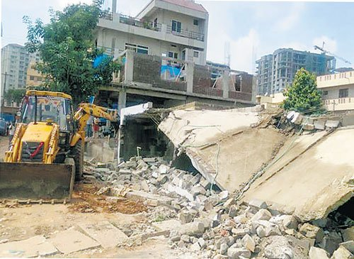 Revenue officials protest 'bullying' by builder, seek police protection